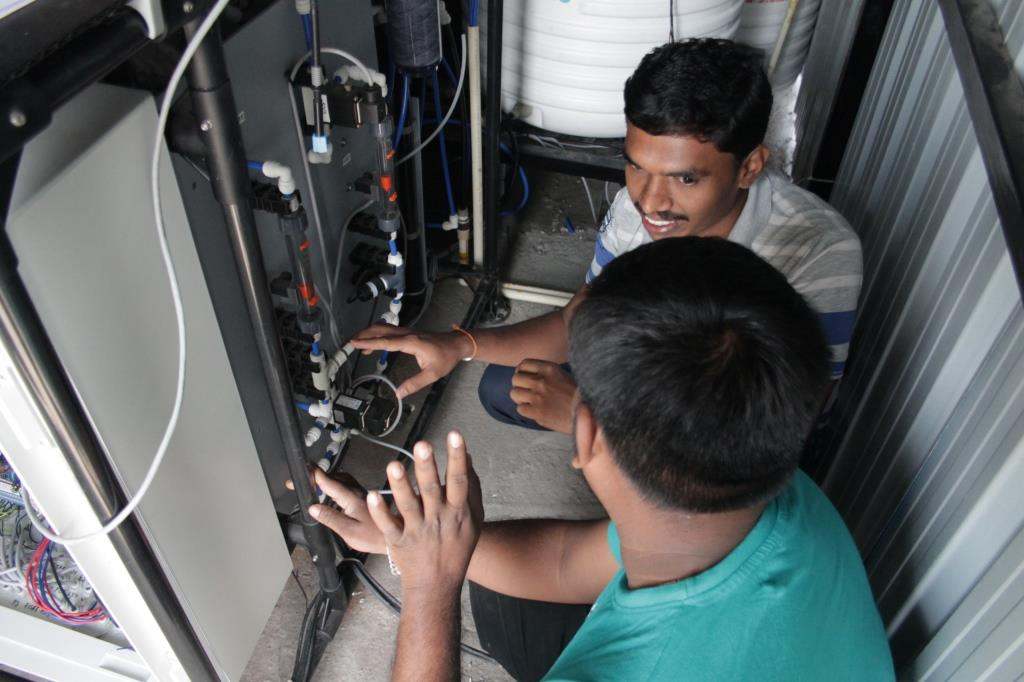 Two local operators are trained on the desalination unit