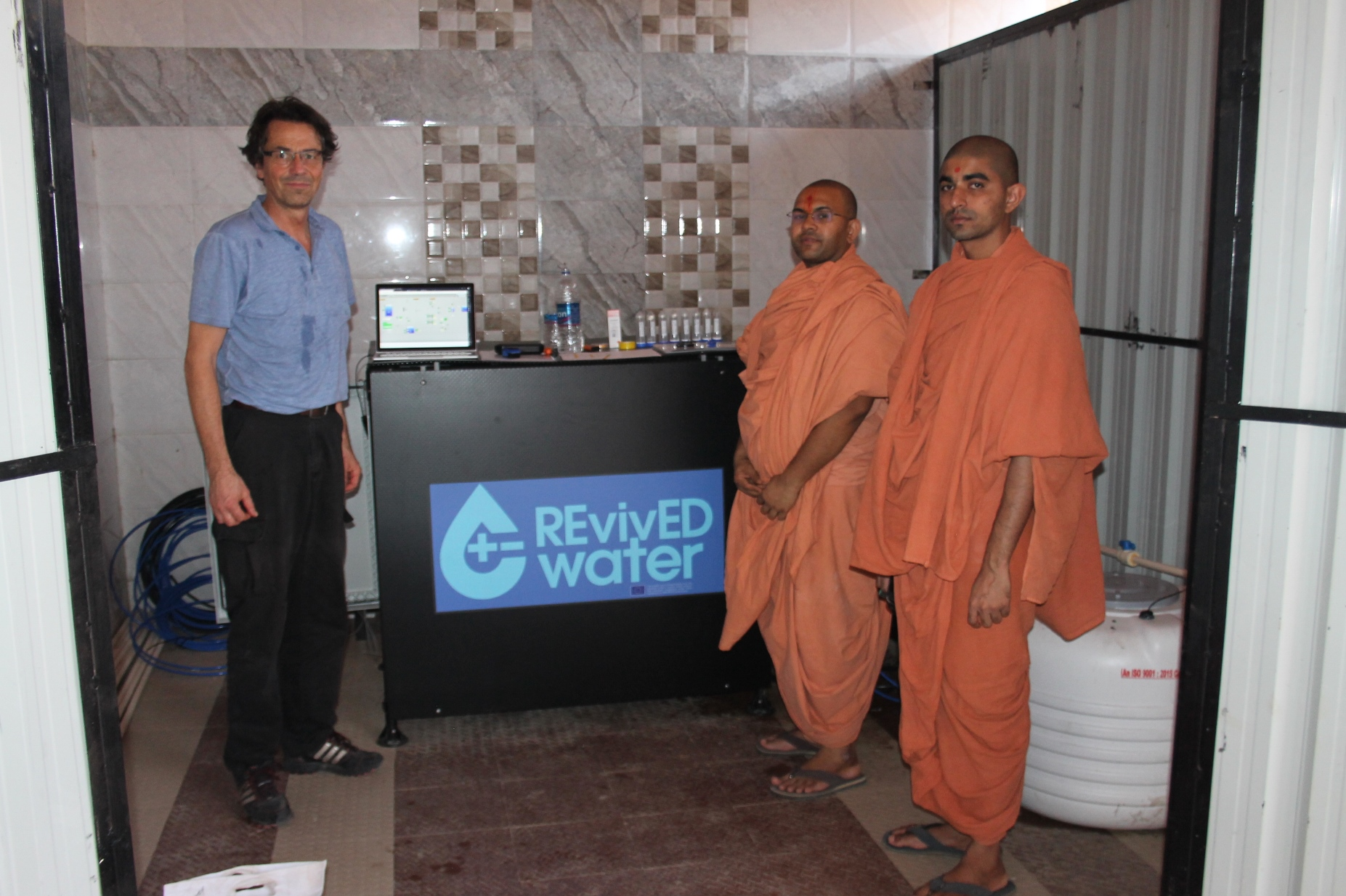 Hindu monks visit the installation.